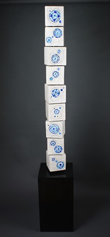 Interactive Totem Made of clay, glass, iron wash, wood, steel