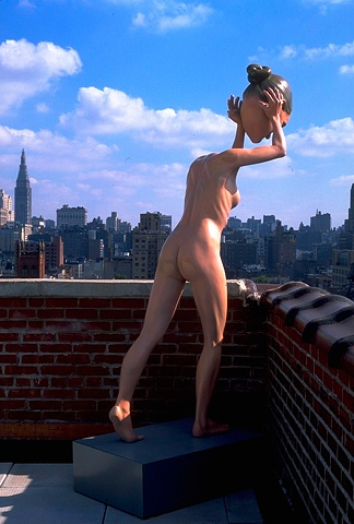 Nude headless woman throwing an oversized grinning head off a rooftop in Chelsea, NYC