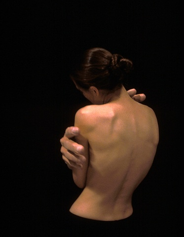 Woman's head and back with sculpted large hands