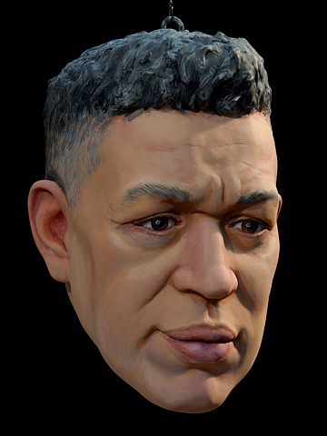 polychrome figurative portrait head of artist Andres Serrano