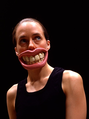 Cibachrome image of  a woman wearing sculpted oversize teeth and lips