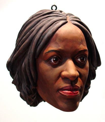 sculpted painted portrait of gallerist Florence Lynch