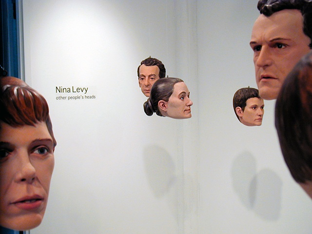 several portrait heads installed at Metaphor Contemporary Art Gallery