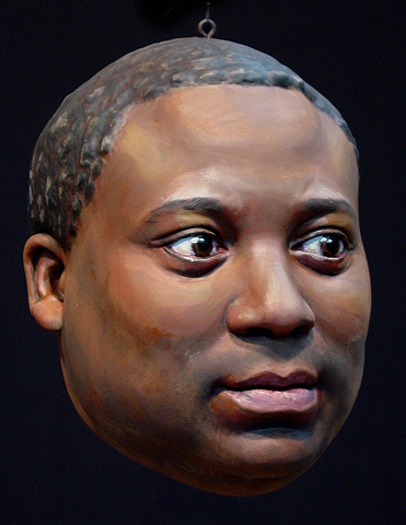 sculpted, painted portrait head of artist Rico Gatson