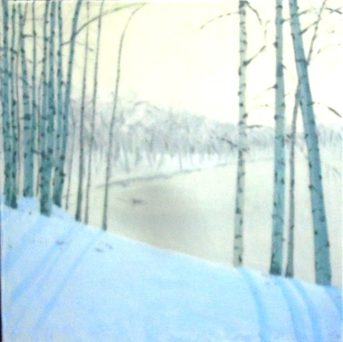 Birches in winter with lake in the distance