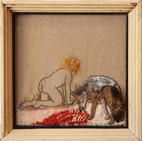 Baby with coyote and animal carcass