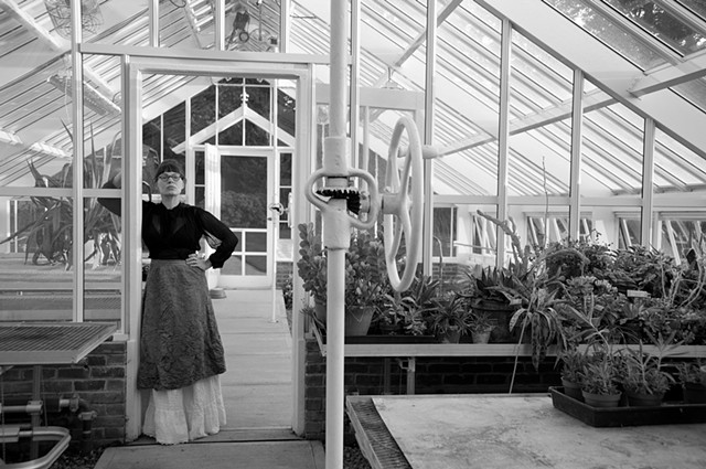 Florence Hopewell in her greenhouse, circa 1909