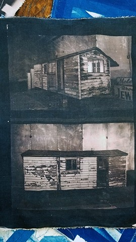 Toned cyanotype on fabric of Castle's Cozy Cottage Trailer.
