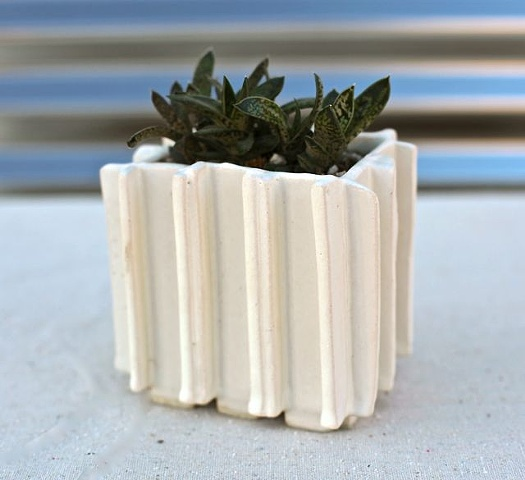 small white extrusion planter