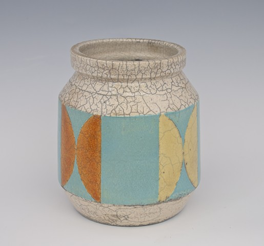 medium raku urn- blue with orange and yellow semi-circle design