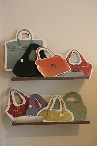Handbags on shelves