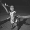 Young Boy Under A Streetlight