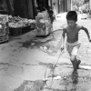 Boy Playing With A Hoop