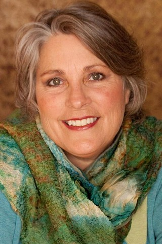 My dear  friend Deb wearing her Nuno Scarf.  The colors really compliment her pretty with her eyes!