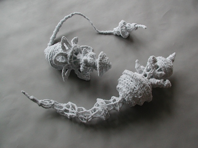 Chenille stem sculptures in the shape of imaginary sea creatures