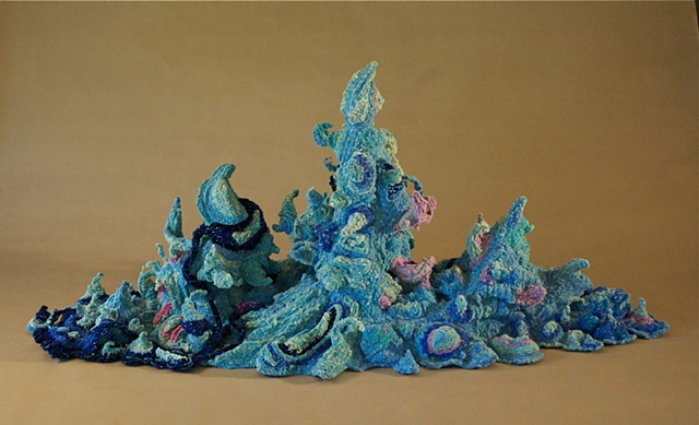 Chenille stem sculpture of a splash, part of the movement of water series.