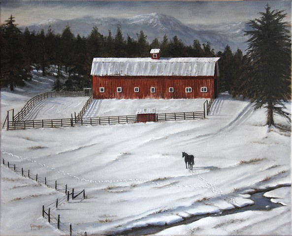 A black horse and a red barn on an icy Montana winter day.