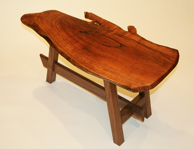 Contemporary end table--free edge mesquite top with butterfly inlays, black walnut base.