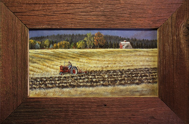 A Flathead valley Montana farmer, on his vintage Farmall tractor, turns the stubble in his fields as Autumn arrives.