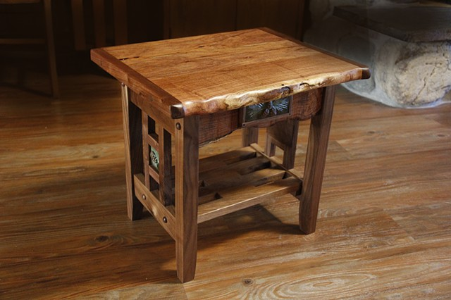 Small specialty table with natural edge Mesquite top and front, and Black Walnut base.