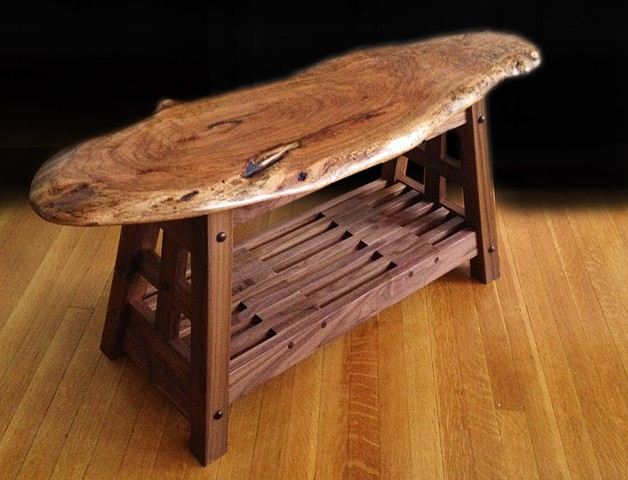 Natural edge Mesquite bench with black walnut base.