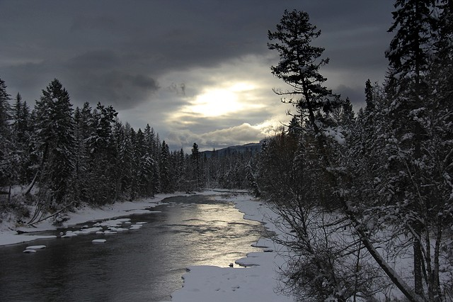 An early winter sun casts an eerie glow over the Swan River in northwestern Montana.