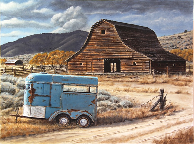 A rustic barn and rusting horse trailer speak of better days that have come and gone on this Montana ranch west of Flathead Lake.