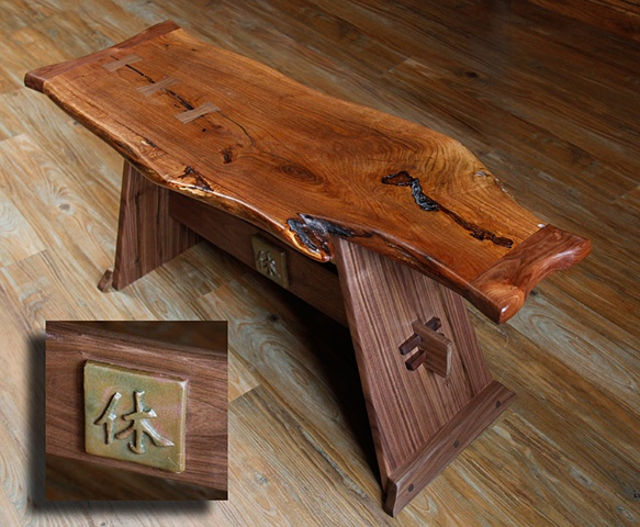 A Nakashima inspired bench with a free edge Mesquite top, Walnut butterfly inlays, and a Walnut Base.