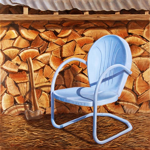 A blue chair rests beside this year's  firewood.