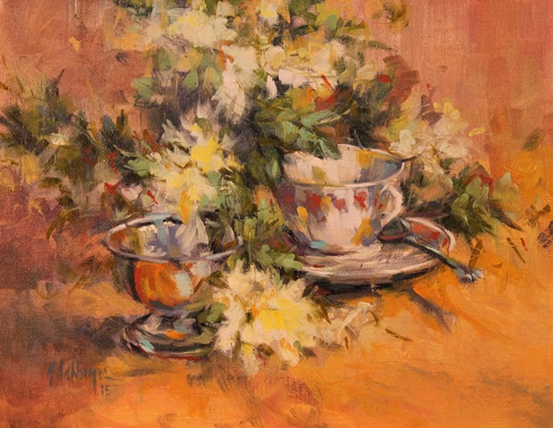 Floral with white blossoms and teacup