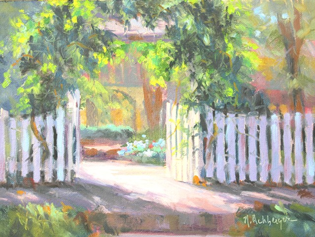 White fence and arbor