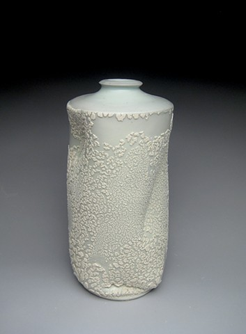 thrown and altered porcelain, celadon glaze, white crawl glaze, vase,