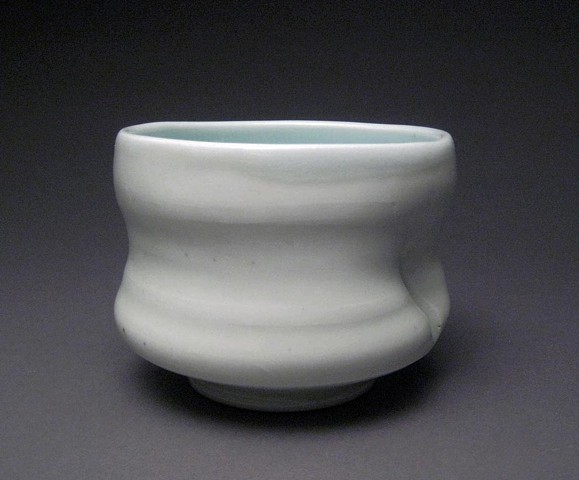 wheel thrown and altered porcelain, celadon glaze,