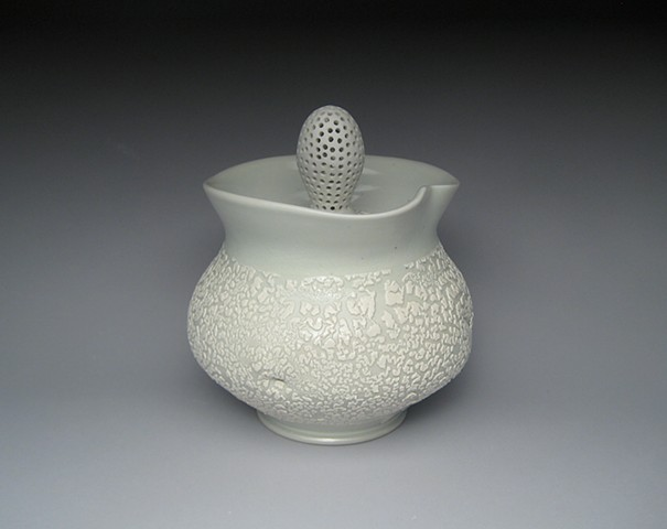 thrown and altered porcelain, celadon glaze, white crawl glaze, covered jar,