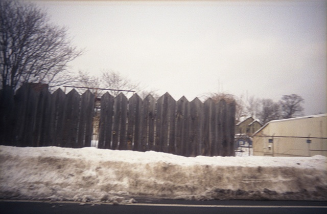 color photography of fence and snow in winter by iris grimm