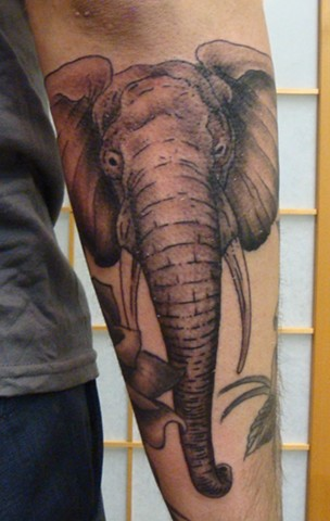 920 tattoo, steve anderson, tattoos, tattoo, tattooed, forearm tattoos, elephant, elephant tattoos, never forget, wisconsin, oshkosh
