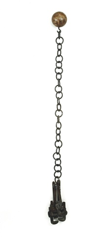 handwrought steel chain, wrenches, bowling ball, wall sculpture