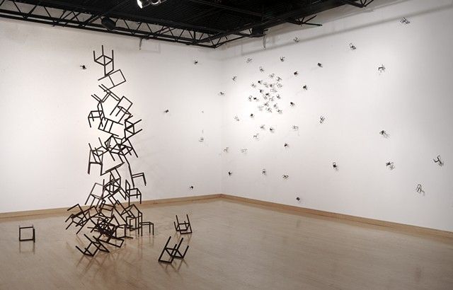 welded steel chairs depicting the relationship between Cassiopeia and her daughter Andromeda in sculpture and installation. woman welding welds, steel.