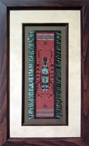 A long horned beetle from Thailand woven in sewing thread