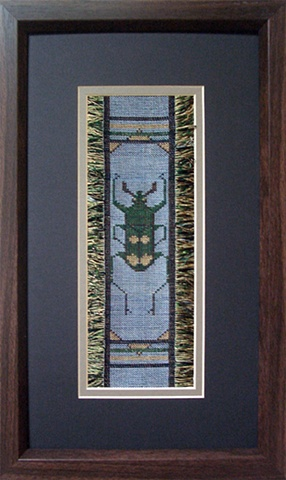 A  beetle from Thailand woven in sewing thread