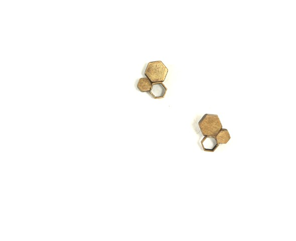 Triad earring: brass hexagons of various sizes, simply atomic by Jennifer Bennett