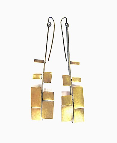 "Earring  ""swordfern"" made from oxidized silver with brass squares and rectangles."