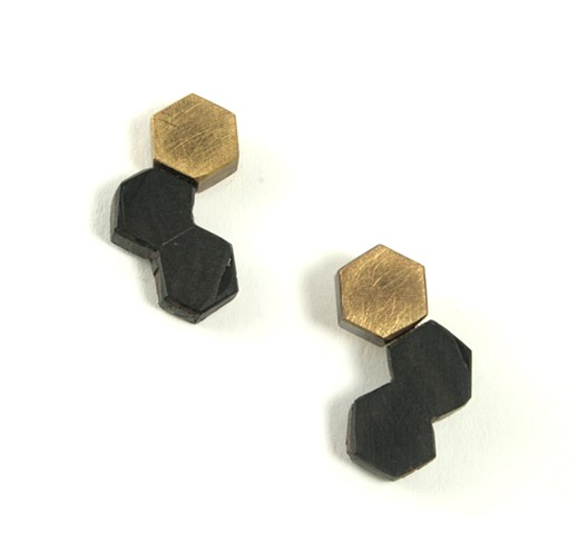 Earring made of reclaimed honey ebony, brass, and silver posts by Jennifer Bennett
