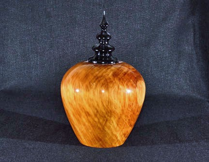 Lidded vessel with turned finial