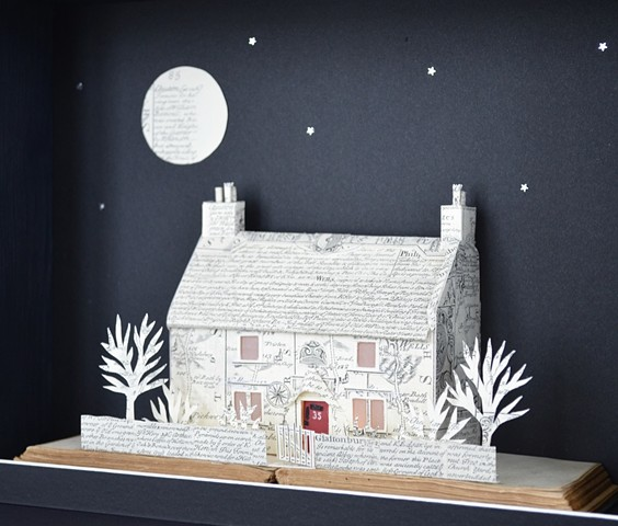 An English thatched cottage made from copies of old Bowen Maps. Paper Art