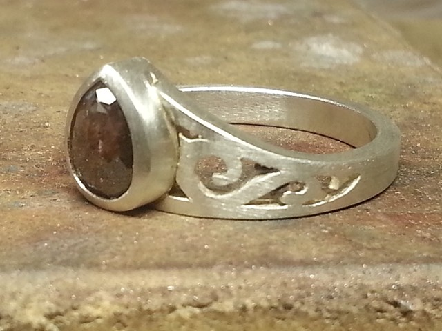 Hand forged and fabricated sterling silver ring set with a pear-shaped natural brown opaque rose cut diamond