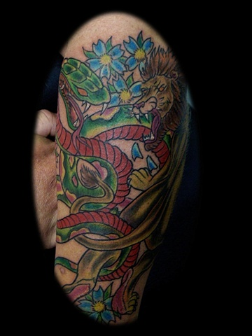 lion and snake tattoo by tatupaul.com