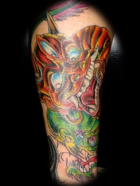 dragon face tattoo by tatupaul