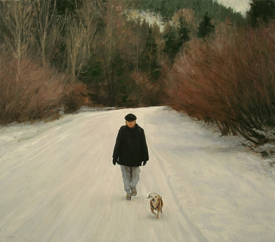 Winter landscape, road, snow and forest, woman and dog walking toward viewer.