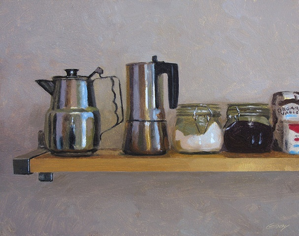 Kitchen shelf with metal coffee pots, objects.
